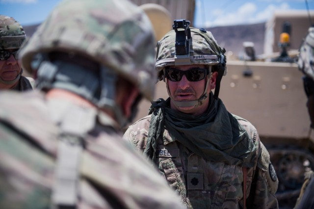 Idaho Army National Guard Lt. Col. Lee Rubel, commander, 116th Brigade Engineer Battalion, discusses his task force's National Training Center mission with Brig. Gen. Anthony V. Mohatt June 1, 2019, at Fort Irwin, California. Mohatt, commander, Kansas Army National Guard, was at the National Training Center to visit Soldiers from the 891st Engineer Battalion's 242nd Engineer Company and 772nd Engineer Mobility Augmentation Company. The two companies are supporting the 116th Cavalry Brigade Combat Team's National Training Center rotation.Units from 13 Army National Guard states and territories are supporting the 116th CBCT's rotation May 24 through June 20. The rotation builds unit and Soldier proficiency to provide combatant commanders with a trained and ready force capable of fighting and winning our nation's wars.