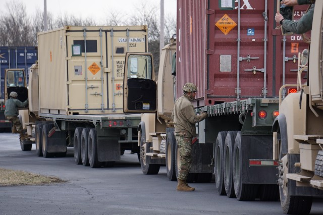 A 432nd Transportation Company, U.S. Army Reserve - Puerto Rico Soldier prepares for Letterkenny Munitions Center to unload the shipping container from his flatbed in support of Operation Patriot Bandoleer.