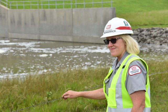 Elk City Lake Park Ranger Barb Busenbarrick clears debris downstream of the Elk City Lake spillways June 3. The lake elevation is currently about 1 foot above the spillway elevation of 825 feet. Following historic rains, the Elk City Lake staff began 24-hour operations to monitor the dam and ensure it was performing as designed. The staff are managing water releases in accordance with the Tulsa District's water management engineers' requests as the engineers try to minimize flood impacts across the entire region.