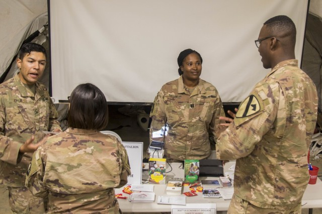 Army Cpl. Andres Cruz, left, a behavioral health specialist and Capt. Tiffany Taylor, a behavioral health officer, both assigned to the 300th Special Troops Battalion, 300th Sustainment Brigade, 4th Expeditionary Sustainment Command, staff a station and visit with Soldiers at the safety rodeo hosted by the Headquarters and Headquarters Company, 300th Special Troops Battalion on Camp Arifjan, Kuwait, May 7, 2019. This event serves to educate Soldiers on how to minimize and prevent accidents or injuries and to increase safety awareness. (U.S. Army Reserve photo by Sgt. Christopher Lindborg)