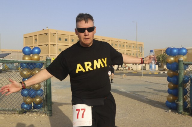 CAMP ARIFJAN, Kuwait - Army Capt. John Reich, a public affairs officer with U.S. Army Central, participates in the Army Reserve's 111th birthday celebration 5K at Camp Arifjan, Kuwait, April 26, 2019. U.S. Army Central participates in events such as the birthday celebration to show commitment to the total force. (U.S. Army Reserve photo by Sgt. Christopher Lindborg, U.S. Army Central Public Affairs Office)