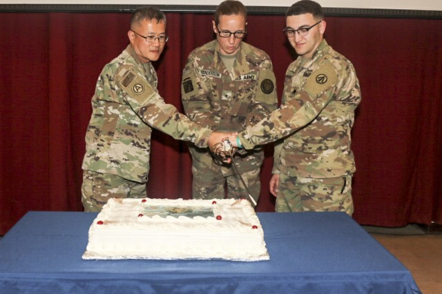 CAMP ARIFJAN, Kuwait - Army Brig. Gen. Susan Henderson, center, Combined Joint Task Force-Operation Inherent Resolve, Army Sgt. 1st Class Winston Ha, left, and Army Spc. Eric Borski, both with the 1173rd Deployment and Distribution Support Battalion, 595th Transportation Brigade, cut a cake during the Army Reserve's 111th birthday celebration cake cutting ceremony at Camp Arifjan, Kuwait, April 26, 2019. U.S. Army Central participates in events such as the birthday celebration to show commitment to the total force. (U.S. Army Reserve photo by Sgt. Christopher Lindborg, U.S. Army Central Public Affairs Office)