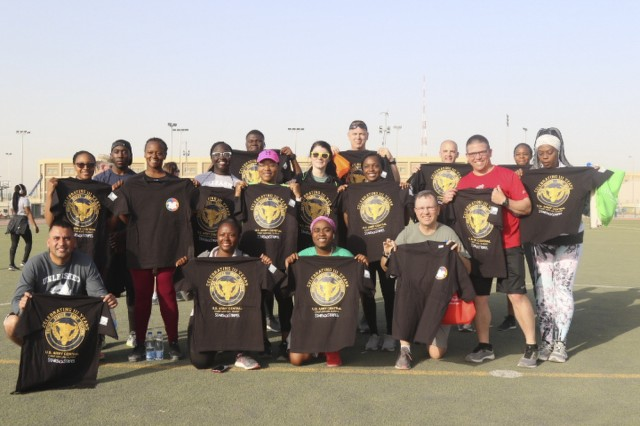 CAMP ARIFJAN, Kuwait - Soldiers with 3rd Human Resources Command show T-shirts they earned after participating in the Army Reserve Birthday celebration 5K at Camp Arifjan, Kuwait, April 26, 2019. U.S. Army Central participates in events such as the birthday celebration to show commitment to the total force. (U.S. Army Reserve photo by Sgt. Christopher Lindborg, U.S. Army Central Public Affairs Office)