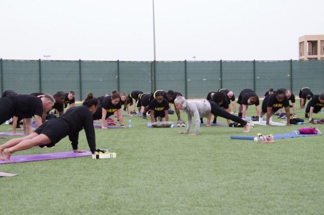 CAMP ARIFJAN, Kuwait -- Paula LeBov, American Red Cross employee and Camp Arifjan, Kuwait resiliency program manager, teaches a yoga class during early morning physical fitness training April 3, 2019 at Camp Arifjan, Kuwait. U.S. Army Central (Forward) invited LeBov to introduce Soldiers to yoga to build resiliency. Collective physical readiness training is conducted weekly by ARCENT (FWD) to maintain physical readiness and preparedness. (U.S. Army Reserve photo by Sgt. Jennifer Shick)