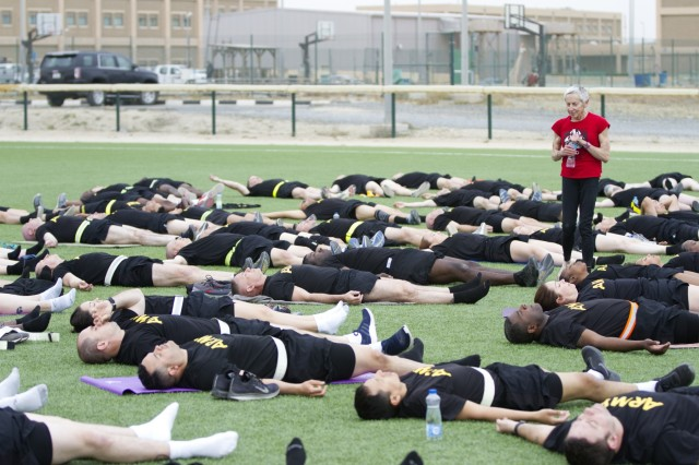 CAMP ARIFJAN, Kuwait -- Paula LeBov, American Red Cross employee and Camp Arifjan, Kuwait resiliency program manager, guides Soldiers through a relaxation exercise during an early morning yoga class April 3, 2019 at Camp Arifjan, Kuwait. U.S. Army Central (Forward) invited LeBov to introduce Soldiers to yoga to build resiliency. Collective physical readiness training is conducted weekly by ARCENT (FWD) to maintain physical readiness and preparedness. (U.S. Army Reserve photo by Sgt. Jennifer Shick)