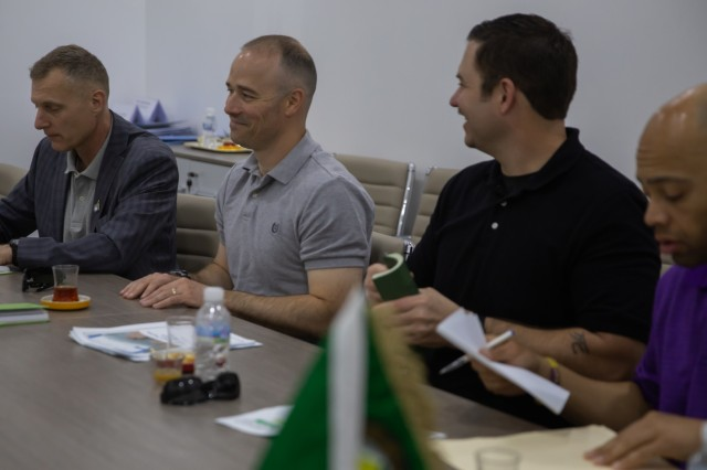 From left, Lt. Col. Chuck Moore, Task Force Spartan Civil Affairs; Lt. Col. Dan Gardner, U.S. Army Central (USARCENT) Civil Affairs Support Detachment (CASD), Detachment 9 commander; Staff Sgt. John Lee, USARCENT CASD; and Capt. Jermareo McDaniel, USARCENT CASD, engage in conversation during a key leader engagement with Gulf Cooperation Council Emergency Management Center (GCC-EMC), to help build and establish interoperability between the U.S. government, Kuwait and the GCC-EMC March 24, 2019 in Kuwait. Coordinating a working relationship with our allied partners builds camaraderie and helps better understand GCC-EMC capabilities that will lead to GCC participation in Eagle Resolve 2020. (U.S. Army Reserve photo by Spc. Arielle Lugtu)