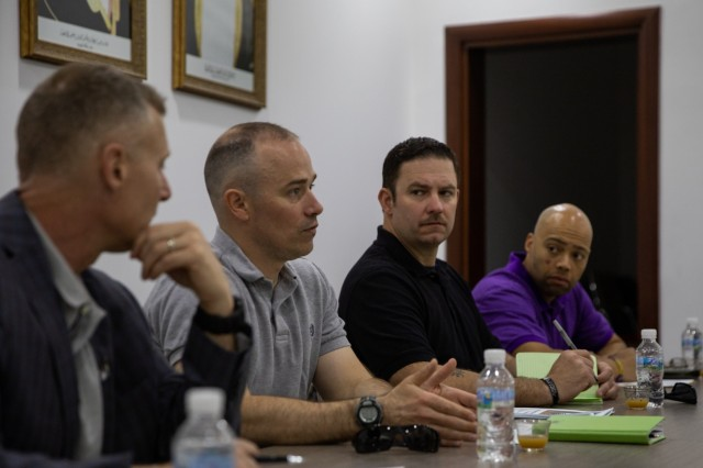 Lieutenant Col. Dan Gardner, U.S. Army Central (USARCENT) Civil Affairs Support Detachment (CASD), Detachment 9 commander; Staff Sgt. John Lee, USARCENT CASD; and Capt. Jermareo McDaniel, USARCENT CASD; engage in conversation during a key leader engagement with Noor Al Shebli, Gulf Cooperation Council Emergency Management Center (GCC-EMC) risk planning director, to help build and establish interoperability between the U.S. government, Kuwait and the GCC-EMC March 24, 2019 in Kuwait. Coordinating a working relationship with our allied partners builds camaraderie and helps better understand GCC-EMC capabilities that will lead to GCC participation in Eagle Resolve 2020. (U.S. Army Reserve photo by Spc. Arielle Lugtu)