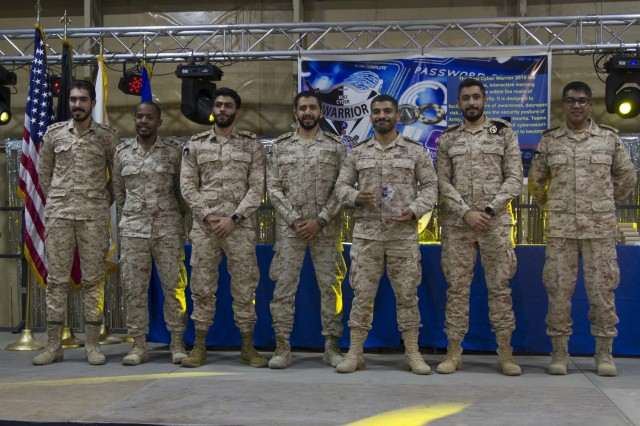 "Participants from the Kuwait Ministry of Defense pose for a photo after placing second in the game ""Are You Smarter Than a Cyber Tech?"" at the 2019 Best Cyber Warrior Competition at Camp Arifjan, Kuwait, May 16, 2019. United States Army Central approved 335th Signal Battalion (Theater) (Provisional) to host this event to challenge the cyber skills of service members and host nation allies while strengthening the bond of its foreign partners. (U.S. Army Reserve photo by Spc. Ashton Koller)"