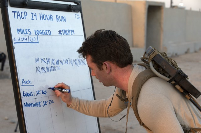 """CAMP BUEHRING, Kuwait - Senior Airmen Justin Evans, a tactical air control party specialist with the 82nd Expeditionary Air Support Operation Squadron, logs his 30th mile on the leaderboard during the Tactical Air Control's (TACP) eighth annual 24-hour challenge, March 28, 2019 at the Camp Buehring track. Evans teamed with 1stLT Joshua Martinez to compete in the ultra-ruck two person team event. """"If we hit 60 miles we have a chance to win the challenge as a team."""" said Evans."""
