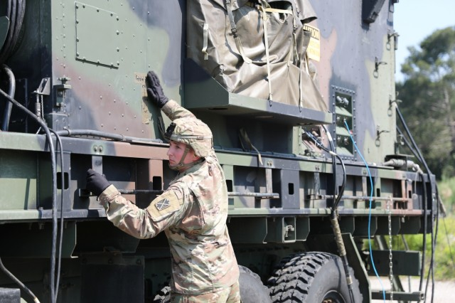 Spc. Jack Boucher, a Patriot Fire Control Enhanced Operator with the 5th Battalion 7th Air Defense Artillery Regiment checks to make sure radar equipment is clear for use during a drill in Koper, Slovenia, June 4, 2019. The drill was part of exercise Astral Knight 19, a multinational combined exercise designed to test integrated air and missile defense capabilities. U.S. Army photo by Sgt. Erica Earl