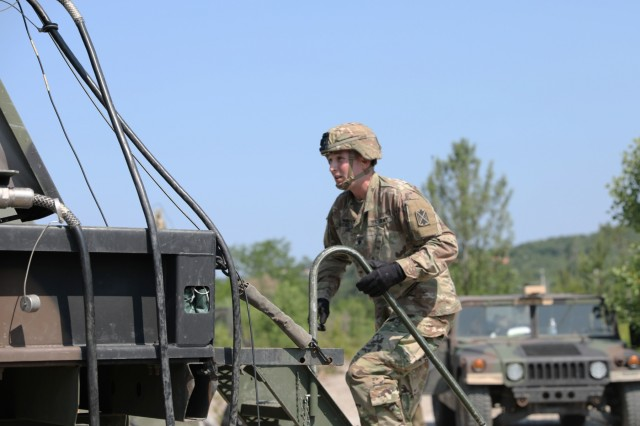 Spc. Jack Boucher, a Patriot Fire Control Enhanced Operator with the 5th Battalion 7th Air Defense Artillery Regiment, runs to simulate the activation of the radar equipment during a drill in Koper, Slovenia, June 4, 2019. The drill was part of exercise Astral Knight 19, a multinational combined exercise designed to test integrated air and missile defense capabilities. U.S. Army photo by Sgt. Erica Earl