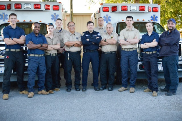 A few of the Soldiers and Civilians of the Fort Stewart EMS team pose for a photo during EMS Week. Pictured center, Jim Ochoa, EMS Chief said he is very proud of his team.