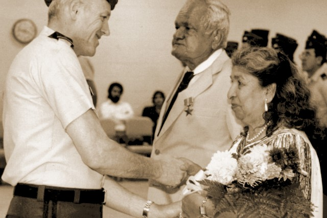 Almost 50 years after World War II, Maj. Gen. Ralph O. Doughty, former commanding general of the 90th U.S. Army Reserve Command, presented the Bronze Star to my father, Sgt. Joe G. San Miguel, at a ceremony in San Antonio on June 6, 1992, only a day after his 71st birthday. (U.S. Army photo)