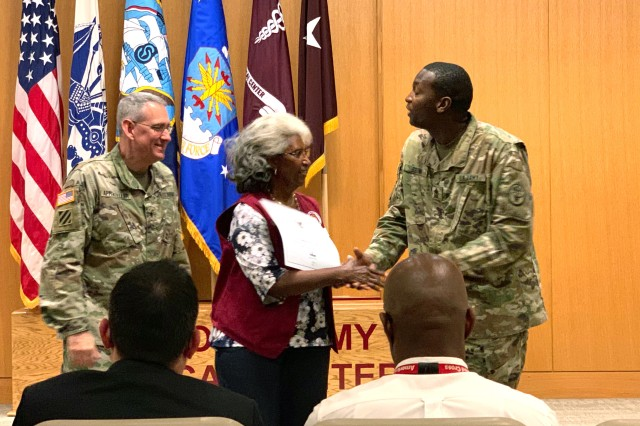BAMC Commanding General Brig. Gen. George Appenzeller and Sergeant Maj. James Brown present Barbara Williams with the President's Lifetime Achievement Award on May 30, 2019 for her over 4,750 service hours at the community/refill pharmacy on Fort Sam Houston.