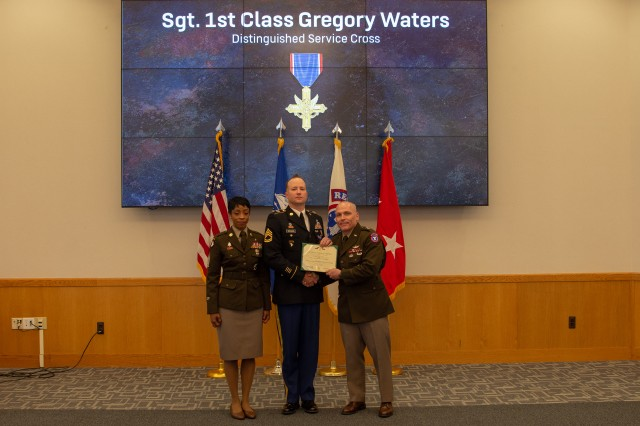 U.S. Army Recruiting Command Team, Maj. Gen Frank Muth and Command Sgt. Maj. Tabitha Gavia present Sgt. 1st Class Greg Waters with the Distinguished Service Cross