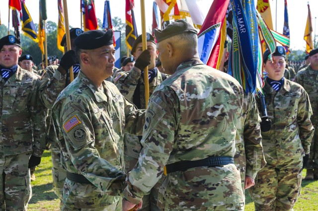 Gen. Michael X. Garrett, commanding general of U.S. Army Forces Command, passes the 3rd Infantry Division colors to Maj. Gen. Antonio A. Aguto, Jr. the commanding general  of the 3rd Infantry Division, during the division change of command ceremony at Cottrell Field on Fort Stewart, Ga. June 3, 2019. (U.S. Army photo by Master Sgt. Sheila L. Cooper)
