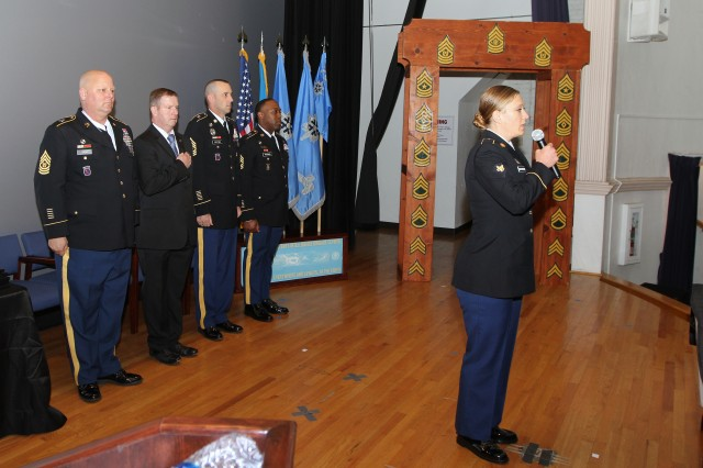 SPC Moorman sings the National Anthem at the 780 MI BDE NCO Induction Ceremony