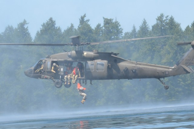 Soldiers from the 2nd Assault Helicopter Battalion, 158th Aviation Regiment, 16th Combat Aviation Brigade in conjunction with the 1st Special Forces Group (Airborne) conducted helocast training at American Lake May 30.