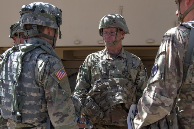 Idaho Army National Guard Capt. Richard Main (left), commander, D Company, 116th Brigade Engineer Battalion, discusses the role of the military intelligence company and brigade intelligence support element in the brigade fight with Birg. Gen. Michael K. Hanifan, deputy commanding general, United States Army Intelligence Center of Excellence, June 4, 2019. Hanifan visited the 116th Cavalry Brigade Combat Team's intelligence officers and sections during the brigade's National Training Center to see firsthand how the Army's school for professional training of military intelligence prepares Soldiers to operate in a combat training center environment.