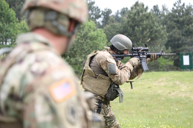 A Slovenian soldier fires at a joint weapons qualification range with the 220th Military Police Company of the Colorado National Guard and the 174th Air Defense Artillery Brigade of the Ohio National Guard. The range was in addition to joint marksmanship training that included firearms techniques such as assuming a good firing stance and performing tactical reloads.