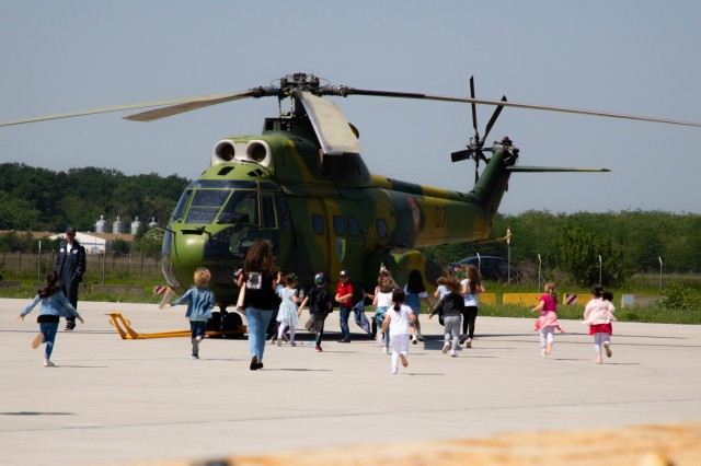 Students from local schools in Constanta, Romania run to a romanian helicopter to explore during a field trip at the Mihail Kogalniceanu International Airport, Romania, May 29, 2019. US, Italian and Romanian Armed Forces gave the children a chance to see and interact with real military aircraft, vehicles and equipment and was also a good opportunity for military personnel to meet the locals. This event is hosted annually by the Mihail Kogalniceanu International Airport. (U.S. Army photo by Pvt. Laurie Ellen Schubert, 5th Mobile Public Affairs Detachment)