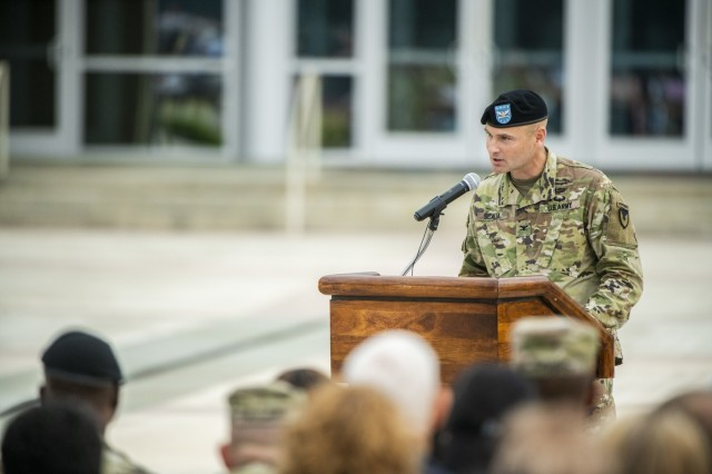 FORT BENNING, Ga -- Col. Matthew Scalia speaks at the podium after assuming command of U.S. Army Garrison Fort Benning from Col. Clinton W. Cox during a change of command ceremony June 5 on York Field. (U.S. Army photo by Patrick Albright, Maneuver Center of Excellence, Fort Benning Public Affairs)