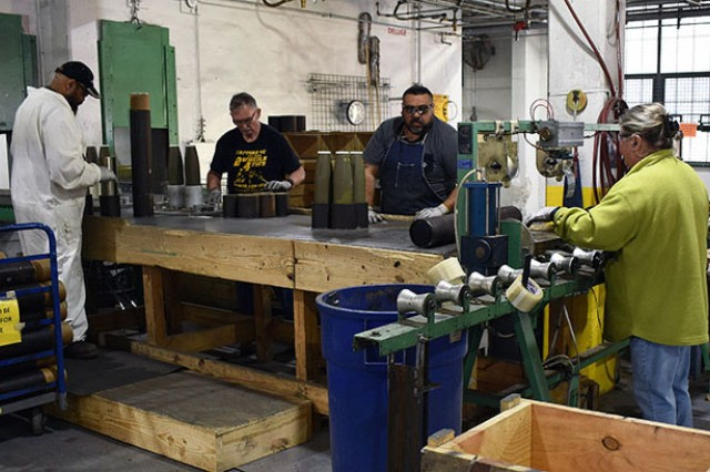 Blue Grass Army Depot staff rejoin propellant cases with inspected projectiles and are sealed.