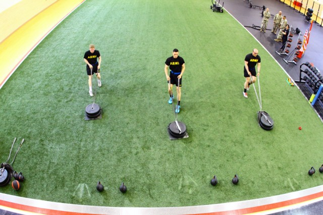 Soldiers from B Battery, 3rd Battalion, 6th Air Defense Artillery demonstrate the sprint-drag-carry event of the new Army Combat Fitness Test during the rededication of Honeycutt Gym and Functional Fitness Center May 29, 2019. One of the features of the remodeled center is an artificial surface. The center is open to all MWR patrons.