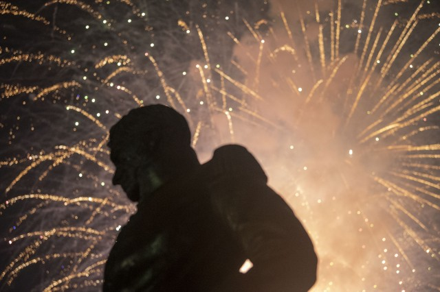 Fireworks explode behind the shadow of the Andrew Jackson statue at Fort Jackson's Hilton Field during the post's 102nd birthday celebration June 1.