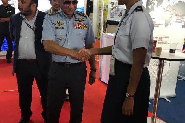 Maj. Chyteira Dues, Washington National Guard Malaysian Bilateral Affairs Officer, greets Gen.Tan Sri Dato' Sri Hj Affendi bin Buang, the Royal Malaysian Air Force Chief, during the Langkawi International Maritime and Aerospace Exhibition in Malaysia March 2019.