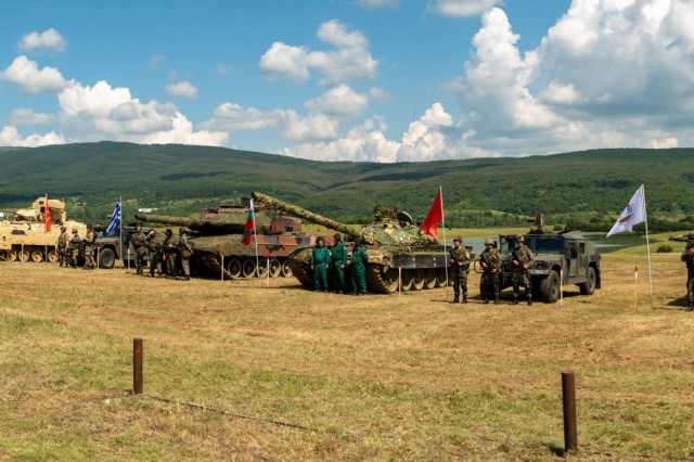 Examples of Bulgarian, Albanian, Greek, North Macedonian and U.S. military vehicles and equipment are displayed at the opening ceremony of STRIKE BACK 19 held June 7, 2019 at Novo Selo Training Area, Bulgaria. STRIKE BACK 19 is a multinational exercise hosted by the Bulgarian Armed Forces at Novo Selo Training Area, Bulgaria, from June 6-20, 2019. STRIKE BACK 19 is designed to increase capabilities and interoperability with Bulgarian, Albanian, Greek, North Macedonian and U.S. Troops.(Photo by Michigan Army National Guard Spc. Samantha Hall)