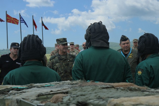 Bulgarian Land Forces Brigadier General Ivan Lalov, 2nd Mechanized Brigade Commander, and Major General Ivan Lalov, Deputy Commander of the Joint Forces, speaks with Greek Army tank soldiers, from the 22nd Battalion, during the opening ceremony of STRIKE BACK 19 at Novo Selo Training Area, Bulgaria, June 7, 2019. STRIKE BACK 19 is a multinational exercise hosted by the Bulgarian Armed Forces from June 6-20, 2019. STRIKE BACK 19 is designed to increase capabilities and interoperabilities with Bulgarian, Albanian, Greek, North Macedonian and U.S. Troops. (U.S. Army photo by Spc. Abigail Graham