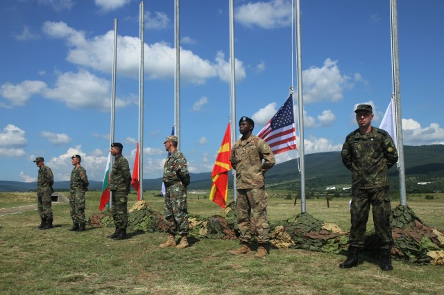 Soldiers from Bulgaria, Albania, Greek, North Macedonian and U.S. Army stand in front of their country's flags at the opening ceremony of STRIKE BACK 19 at Novo Selo Training Area, Bulgaria, June 7, 2019. STRIKE BACK 19 is a multinational exercise hosted by the Bulgarian Armed Forces from June 6-20, 2019. STRIKE BACK 19 is designed to increase capabilities and interoperabilities with Bulgarian, Albanian, Greek, North Macedonian and U.S. Troops. (U.S. Army photo by Spc. Abigail Graham)
