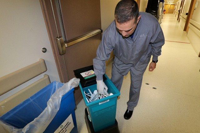 Maj. Sean Shamlian, a registered nurse and interim officer-in-charge of the OR, show some of the items that are collect for reprocessing and future use at Madigan Army Medical Center, Joint Base Lewis-McChord, Wash. on May 17.