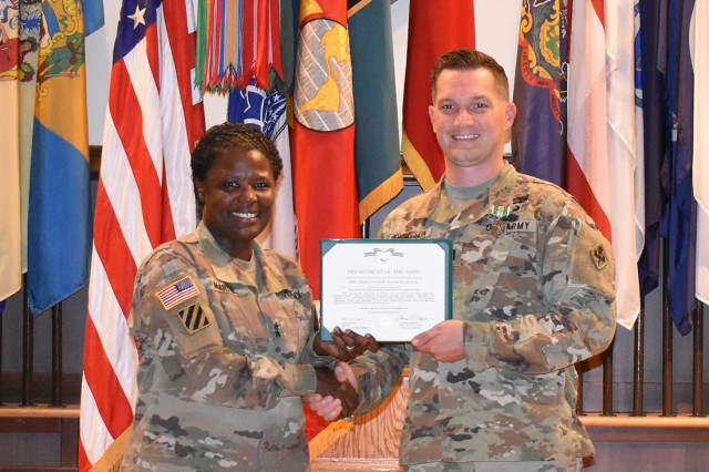 Maj. Gen. Donna Martin poses for a photo with Capt. Joshua Thompson during the MSCoE Instructor of the Year Ceremony held May 30 in Lincoln Hall Auditorium.