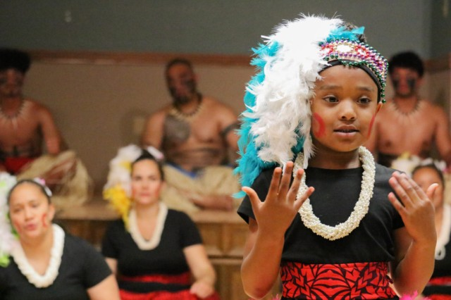 A young dancer performs with the Polynesian Dance Troupe at the Asian American and Pacific Islander Observance May 31.