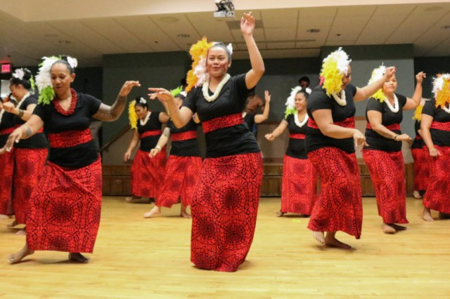 Dancers from the Polynesian Dance Troupe perform at the Asian American and Pacific Islander Heritage Month Observance May 31.