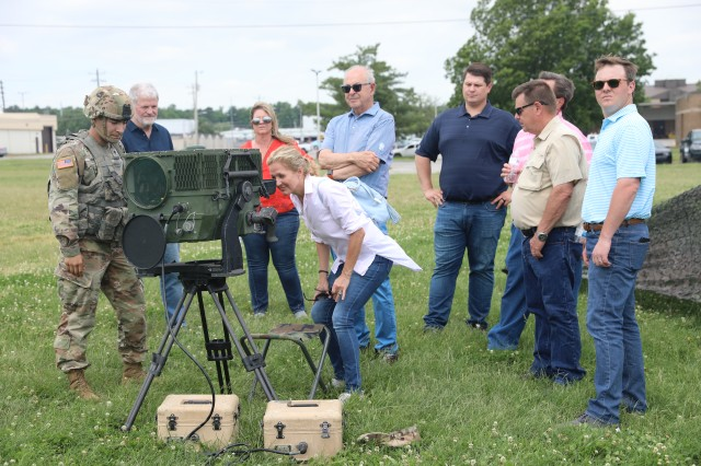 Spc. Jaun Zuniga, Cavalry Scout, Troop B. 1st squadron, 32nd Regiment, 1st Brigade Combat Team, 101st Airborne Division (Air Assault), far left, talks about the capabilities of the Long-Range Advanced Scout Surveillance System at a static display, May 29 during 1st BCT's annual Franklin Rendezvous on Johnson Field on Fort Campbell, Ky. The Franklin Rendezvous is an event designed to allow the citizens of Franklin, Tennessee an opportunity to interact with Fort Campbell Soldiers.