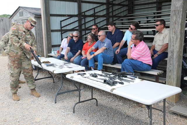 Nine leaders, including Dr. Ken Moore, mayor of Franklin, Tennessee (second from right in the first row), receives preliminary marksmanship instructions May 29 at Range 11 on Fort Campbell, Kentucky before getting an opportunity to fire the M4 Carbine and the M249 Squad Automatic Weapon as part of their visit to the post during 1st Brigade Combat Team, 101st Airborne Division's annual Franklin Rendezvous. The annual event helps Franklin residents broaden their understanding of what life looks like on Fort Campbell.