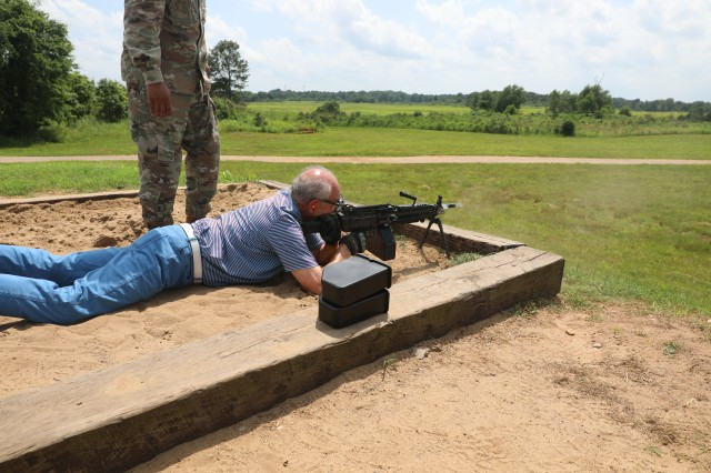 Dr. Ken Moore, mayor of Franklin, Tennessee fires an M249 Squad Automatic Weapon May 29 at Range 11 on Fort Campbell, Kentucky. Moore was one of nine community leaders from Franklin visiting the post as part of 1st Brigade Combat Team, 101st Airborne Division's annual Franklin Rendezvous. The annual event helps Franklin residents broaden their understanding of what life looks like on Fort Campbell.