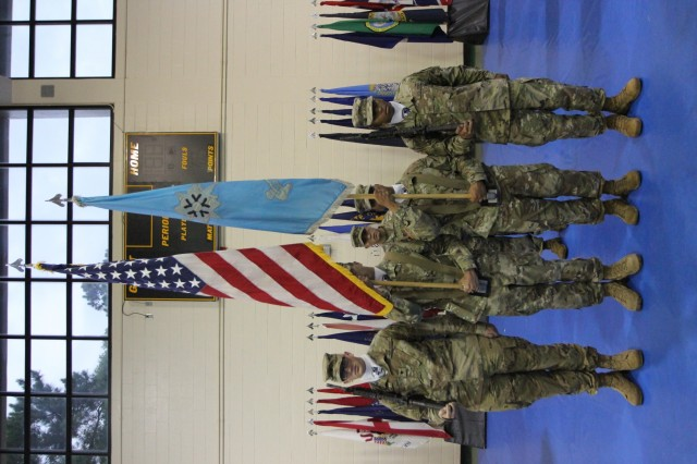 FORT GORDON, Ga. - Command Sgt. Maj. Christian Adkison, the senior enlisted leader for the 782nd Military Intelligence Battalion (Cyber), stands with the battalion Color Guard during a change of command ceremony at the Cyber Fitness Center on June 7.