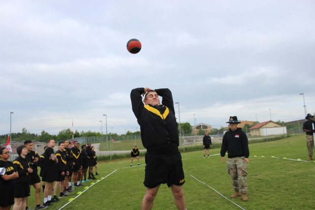 U.S. Army Spc. Steven Carey, intelligence analyst, Headquarters and Headquarters Troop, Regimental Support Squadron, 2d Cavalry Regiment, performs a practice power throw during the squadron Commander's Cup at Rose Barracks, Germany, May 31, 2019. The form required for the power throw often required practice tosses to master for the Soldiers who participated in the event. (U.S. Army photo by 1st Lt. Connor Coombes, 2d Cavalry Regiment)