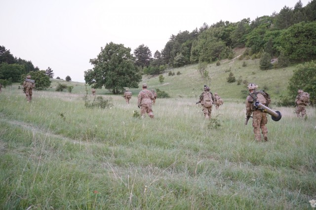 U.S. Army Soldiers from the Apache Troop, 1st Squadron, 2d Cavalry Regiment, commence next line of movement after clearing three buildings for their field training exercise during Saber Guardian 2019 at Ujdorogd, Hungary, June 7-8, 2019. 1/2CR is currently supporting SG19, an exercise co-led by the Romanian Land Forces and U.S. Army Europe that is taking place from June 3 - 24 at various locations in Bulgaria, Hungary and Romania. SG19 is designed to improve the integration of multinational combat forces. (U.S. Army photo by Sgt. LaShic Patterson)