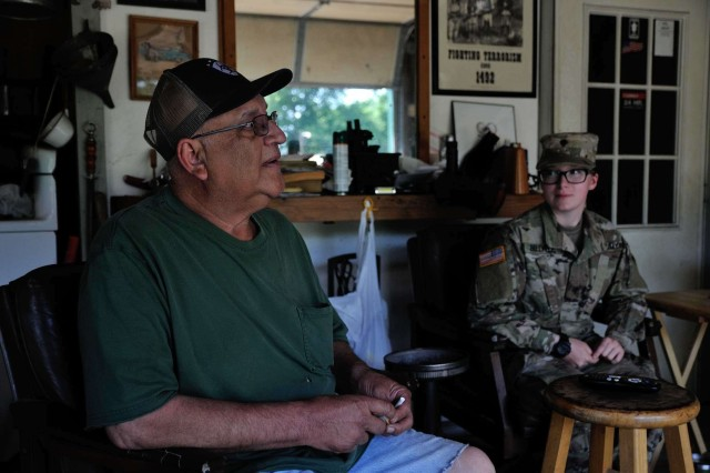 Sand Springs, Oklahoma resident Bob Casebold sits in his garage with Spc. Kailey Bellville, a unit supply specialist in Headquarters Company, 1st Battalion, 279th Infantry Regiment, 45th Infantry Brigade Combat Team, Oklahoma Army National Guard, after she helped lay sandbags around trees at his Sand Springs home May 30, 2019. Oklahoma National Guardsmen are working alongside first responders and emergency personnel to provide disaster relief following record-breaking flooding of the Arkansas River in the Tulsa, Okla. area.