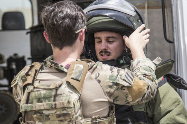 A U.S. Army Soldier from the 744th Explosive Ordnance Disposal Company from Task Force Hellhound puts on his bomb suit on May 2, 2019, for a joint exercise with a simulated terrorist, explosive ordnance, and chemical situation at the Kuwait Special Forces Training Center. The exercise was crafted to build a shared understanding of Kuwait Civil Authorities and U.S. Forces procedures while reacting to any disaster, natural and manmade alike.