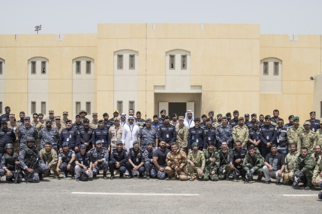 Kuwaiti and U.S. participants of Al Watan One pose for a photo on May 2, 2019, following a joint exercise with a simulated terrorist, explosive ordnance, and chemical situation at the Kuwait Special Forces Training Center. The exercise was crafted to build a shared understanding of Kuwait Civil Authorities and U.S. Forces procedures while reacting to any disaster, natural and manmade alike.