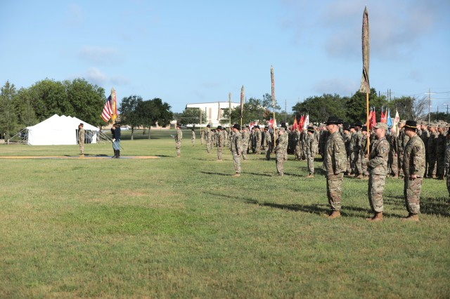 FORT HOOD, Tx-- 3rd Armored Brigade, 1st Cavalry Division along with its 7 battalions stand with their colors cased following a ceremony here June 6. The Brigade cased its colors in preparation for its nine-month rotation to South Korea.