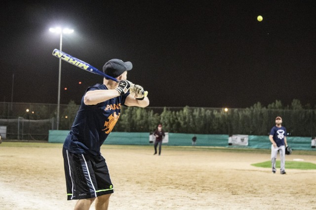 Sgt. Justin Amos prepares to swing a bat during an off-duty softball social event between service members of Task Force Spartan and the local Kuwaiti community on March 15, 2019 at the Hunting and Equestrian Club in Kuwait. The event brought people of all ages, nationality and gender, encouraging participation within the sport and local support for the activities. Soldiers are encouraged to develop a pathway for Community Outreach and Social Partnerships with Sporting Events as part of Every Soldier's an Ambassador program.