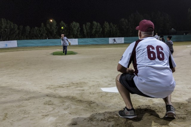 Brig. Gen. Charles Kemper, the Deputy Commanding General for Support of the 34th Red Bull Infantry Division threw the ceremonial pitch to commence an off-duty softball social event between service members of Task Force Spartan and the local Kuwaiti community on March 15, 2019 at the Hunting and Equestrian Club in Kuwait. The event brought people of all ages, nationality and gender, encouraging participation within the sport and local support for the activities. Soldiers are encouraged to develop a pathway for Community Outreach and Social Partnerships with Sporting Events as part of Every Soldier's an Ambassador program.