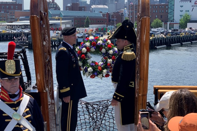 """Brig. Gen. Vincent Malone, deputy commanding general of the Combat Capabilities Development Command (CCDC) and senior commander of the Natick Soldier Systems Center (NSSC), and Cmdr. Nathaniel Shick, 75th commanding officer of USS Constitution, lay a wreath during the first-ever Army/Navy underway cruise aboard """"Old Ironsides"""" to commemorate the 75th anniversary of D-Day."""